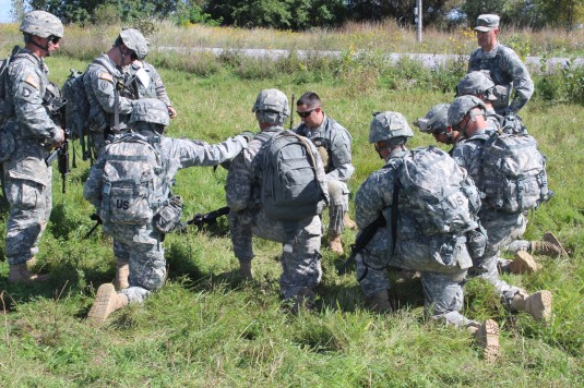 New York Army National Guard Sgt. Benjamin Harrison briefs his squad from Company D 2-108th Infantry as they prepare to participate in the battalion's best squad competition during training here on Sept. 13.