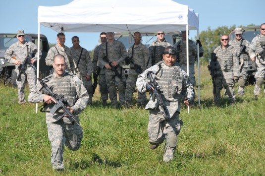 New York Air National Guard Staff Sergeants Michael Crisalli (left) and Ernesto Morales (right) from the 109th Security Forces squadron begin the tactical obstacle course as part of warrior week training at Stratton Air National Guard base 20 Sep 2013.
