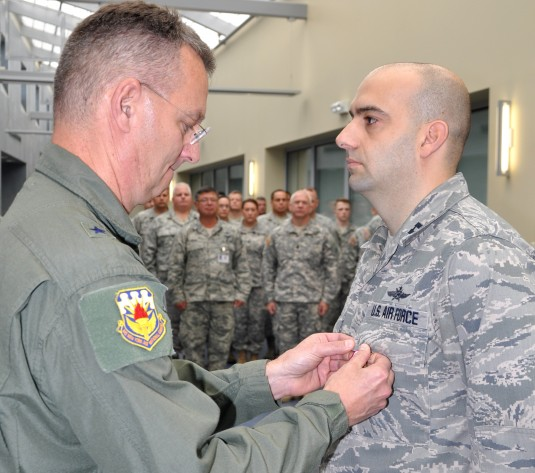 New York Air National Guard Brig. General Anthony German presents the Meritorious Service Medal to Capt. James Vendetti during an awards ceremony here on October 10.