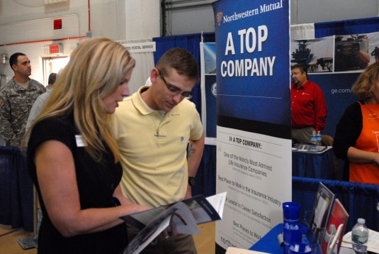 "Kristen Cargill, a representive from Northwestern Mutual Financial Network (left) speaks with New York Army Guard Soldier 1st Lt. John Scott (right) at the U.S. Chamber of Commerce's ""Hiring Our Heroes"" job fair held at the New York Nat"