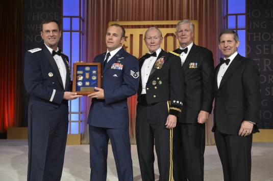 New York Air National Guard Staff Sgt. Christopher Petersen ( second from left) receives a plaque recognizing him as the USO's National Guardsman of the Year for 2013 from National Guard Vice Chief , Lt. Gen. Joseph Lengyel during the USO's annual