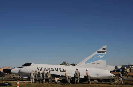 New York Air National Guard members of the 106th Rescue Wing begin the work of dismantling an F-102 Delta Dagger which had been a display aircraft at the F.S. Gabreski Air National Guard Base gate here on Oct. 21.