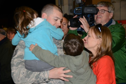 A member of the New York Air National Guard's 107th Airlift Wing reunites with his family at Niagara Falls Air Reserve Station on Thursday, Nov. 7 after returning from a four month deployment in southwest Asia.