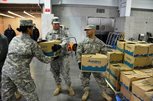 Troops Assist in Holiday Meal Distribution