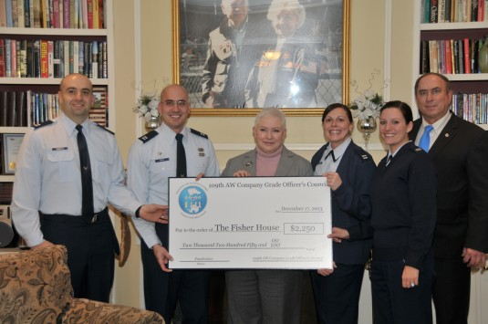 The 109th Airlift Wing Company Grade Officers Council donated 2250 to the Fisher House on Dec. 17 2013 with funds raised from a golf tournament the council hosted earlier in the year.