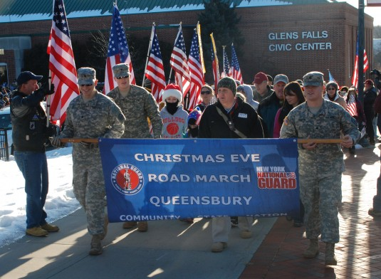 Soldiers lead the participants of the 10th annual Christmas Eve Roadmarch