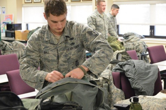 Technical Sgt. Richard Ball of Tonawanda, N.Y. and a member of the 107th Airlift Wing, packs his cold weather gear in preparation for missions