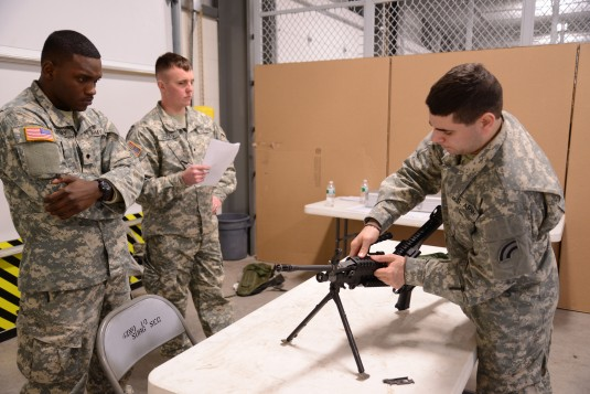 Spc. Steven Smith, an automated logistics Soldier with the 42nd Infantry Division Headquarters Support Company, strips a M249 light machine gun while competing in a Best Warrior Competition at Fort Drum N.Y., Jan. 10.