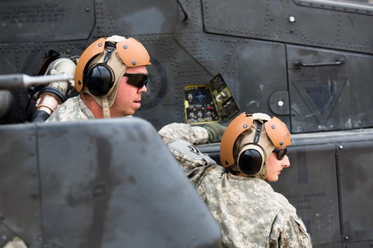 New York Army National Guard Spc. Kyle Perry and Spc. Sarah Bryant, soldiers with A Company, 642nd Aviation Support Battalion, 42nd Combat Aviation Brigade, fuel an AH-64 Apache operated by 4th Battalion, 227th Attack Reconnaissance Battalion, 1st Cavalry