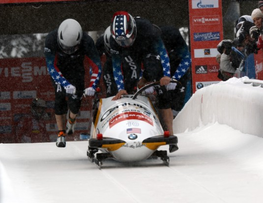 New York Army National Guard Sgt. Nick Cunningham (front) jumps into a bobsled during competition in Utah Olympic Park in Park City Utah on Dec. 7. Cunningham, a bobsled driver, is one of four New York Army National Guard Soldiers who will participate in