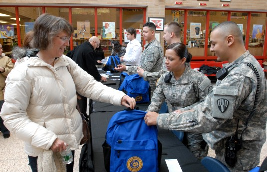 ew York Army National Guard Sgt. Erik Collado (right) gives a disaster and emergency response starter kit to Barbara Peters (left) following a session of New York Governor Andrew Cuomo's Citizen Preparedness Corps Training Program at North Rockland Hi