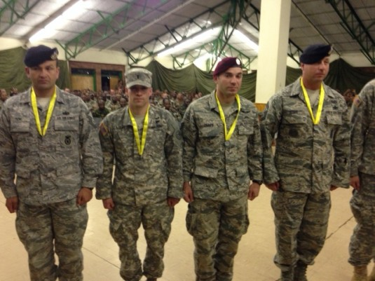 Members of the joint New York Army and Air National Guard team participating in the South African Combat Rifle Competition receive individual marksmanship awards during the competition here.