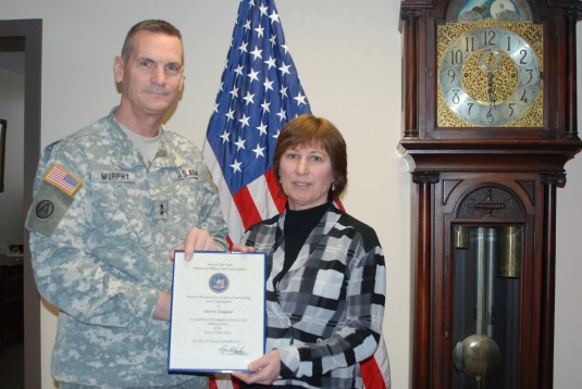 Division of Military and Naval Affairs employee Susan Tousignant was honored for 35 years of service by the Adjutant General, Major General Patrick Murphy, during a short ceremony on Wednesday, March 19.