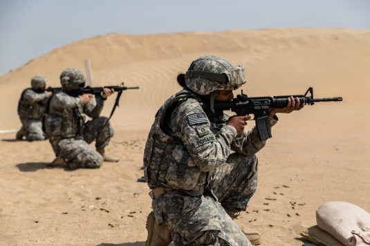 CAMP BEUHRING, KUWAIT-- New York Army National Guard Soldiers from the 42nd Combat Aviation Brigade conduct their annual M-4 qualification on ranges here on March 26, 2014.