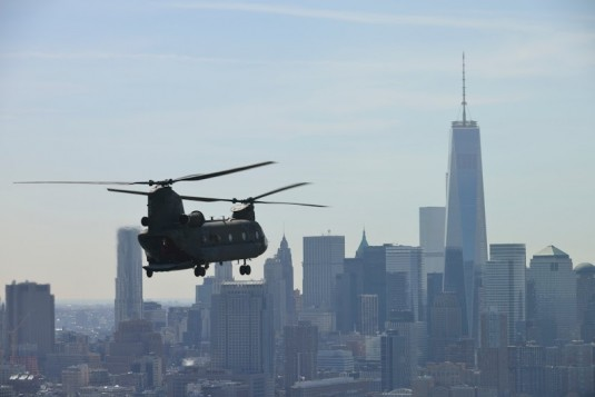 CH-47 Chinook helicopters assigned to the New York Army National Guard's Detachment 1 Company B 3rd Battalion 126th Aviation regiment circle New York City during a training flight on Tuesday, April 1.