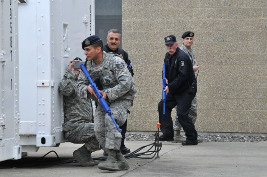 New York Air National Guard Senior Master Sgt. Marc Sommers an observer with the 105th Airlift Wing Inspection Team New York Air National Guard watches Staff Sgt. Flavio Martinez Officers Joe Brescia and Scott Brownely as they respond to an active shooter