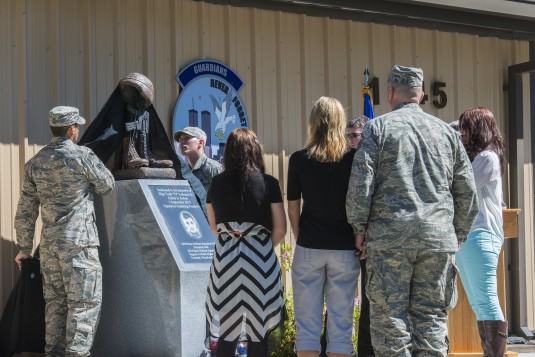 "Family members of New York Air National Guard Staff Sgt. Todd ""TJ"" Lobraico Jr. watch as a memorial is unveiled in his honor during a dedication ceremony April 10, 2014, at Moody Air Force Base, Ga. Lobraico was assigned to the 105th Security Forces Squad"