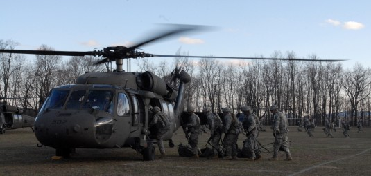 Soldiers of the New York Army National Guard's 1st Battalion, 69th Infantry board UH-60 Blackhawk helicopters of the 3rd Battalion, 142 Aviation here for a mock air-assault exercise at a Fort Dix, New Jersey training area on April 5, 2014.