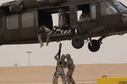 New York Army National Guard Soldiers of Headquarters and Service Company of the 642nd Aviation Support Battalion practice slingloading with a helicopter from Company A 3rd Battalion 142nd Aviation on April 12.