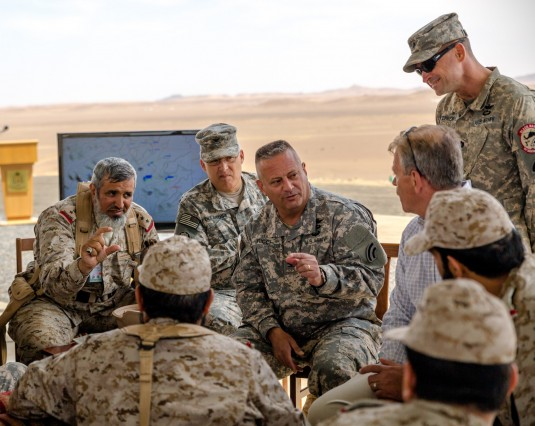 NewYork Army National Guard Col. Albert J. Ricci Sr., commander of the 42nd Combat Aviation Brigade (CAB), speaks to Royal Saudi Land Forces commanders after a practice air assault during  Exercise Friendship and Iron Hawk 14 on April 10th, 2014, near Tab