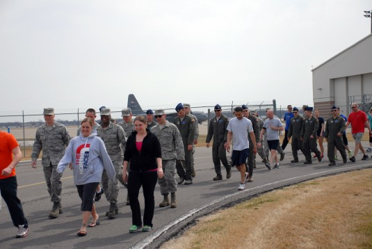 "Members of the 107th Airlift Wing participate in the ""Walk A Mile"" Sexual Assault Awareness Walk held here April 13, 2014. The"