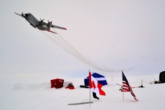 An LC-130 Hercules aircraft from the New York Air National Guard's 109th Airlift Wing flies over Ice Camp One, Sherard Osborn Island, Nunavut during Operation NUNALIVUT on April 15, 2014.
