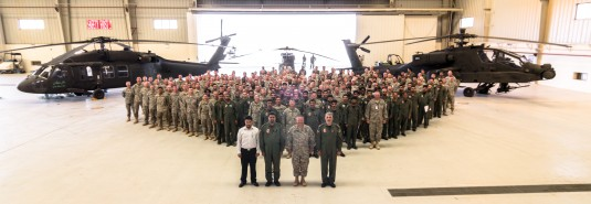Soldiers of the New York Army National Guard's 42nd Combat Aviation Brigade pose with members of the Saudi military and Soldiers from the Delaware Army National Guard and Active Army following an awards ceremony which concluded Exercise Iron Hawk whic