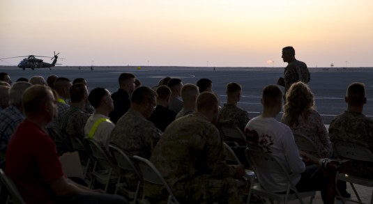 New York Army National Guard Chaplain (Major)  Doug Brock conducts an Easter Sunrise Service for Soldiers of the 42nd Combat Aviation Brigade on the flightline here on Sunday, April 20. There are 450 members of the New York Army National Guard currently d