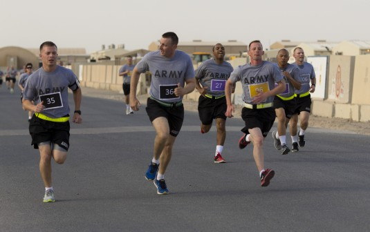 Soldiers deployed to Kuwait, including New York Army National Guard Soldiers of the 42nd Combat Aviation Brigade, take a physical fitness test while attending Camp Buehring's Warrior Leadership Course on May 3, 2014.
