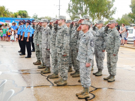 New York Air National Guard Airmen assigned to the 107th Civil Engineer Squadron salute during ANZAC Day ceremonies held here on April 25. The members of the 107th Airlift Wing, based at Niagara Falls Air Reserve Station, were in Australia building a new