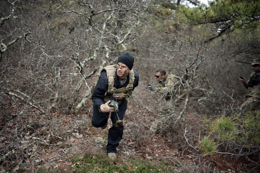 Members of the New York Air National Guard's 106th Rescue Wing conduct Survival Evasion Resistance and Escape (SERE_ refresher training at FS Gabreski Air National Guard Base on May 9th 2014. SERE Specialist Staff Sergeant Brian Alfono led the trainin
