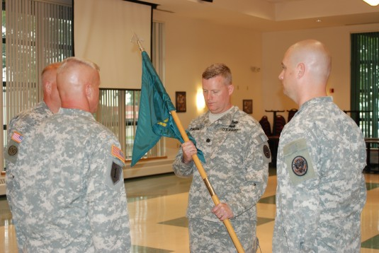STRATTON AIR NATIONAL GUARD BASE, Scotia- Lt. Col. Drew Pinckney receives the guidon of the New York National Guard's 2nd Weapons of Mass Destruction Civil Support Team (CST) during change-of-command ceremonies here on Monday, June 9. Pinckney took ov