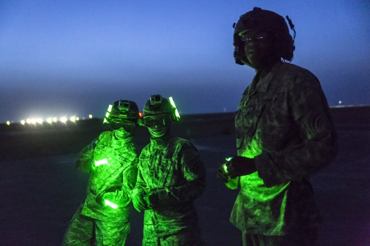 -Soldiers from the 642nd Aviation Support Battalion train with aviators from 3rd Battalion, 142nd Assault Helicopter Battalion, on night sling load operations on June 5, 2014, in Camp Buehring, Kuwait.