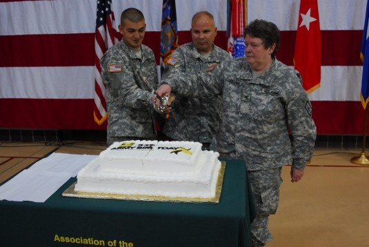 LATHAM- The New York National Guard's oldest Soldier-- 65-year old Col. Joan Sullivan (right)-- joins one of its youngest Soldiers, 19-year old  Pvt. 1st Class Jack Jeffers, (right) and Brig. Gen. Raymond Shields (center) the director of joint staff f