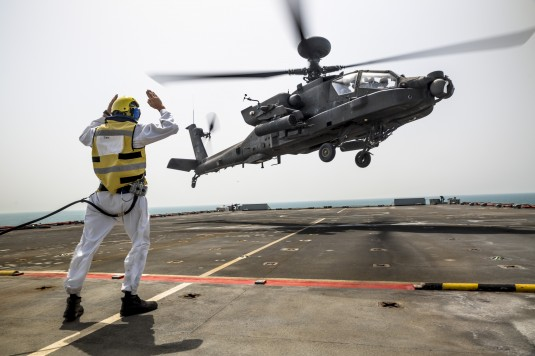 An AH-64 Apache operating under the command of the New York Army National Guard's 42nd Combat Aviation Brigade lands on the British naval auxiliary ship Royal Fleet Auxiliary Cardigan during joint training on June 9.