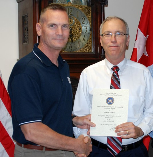 Major General Patrick Murphy ( left) the Adjutant General of New York presents Divison of Military and Naval Affairs Chief Budget Analyst Tom Halabuda with a certifcate marking 30 years of service on Wednesday June 18. Halabuda, a Clifton Park resident an
