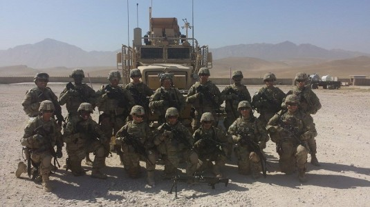 New York Army National Guard Soldiers of 3rd Platoon 1569th Transportation company take time out for a group photo as they prepare to execute a Combat Escort Team mission protecting supplies for coalition forces. The Soldiers from the New Windsor- based N