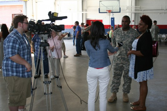 New York Army National Guard Sgt. Juba Jefferson part of the forward detachment of the 102nd Military Police Battalion speaks with a local media reporter at the units deployment ceremony here July 6.  More than 50 Soldiers will deploy to Guantanamo Bay Cu