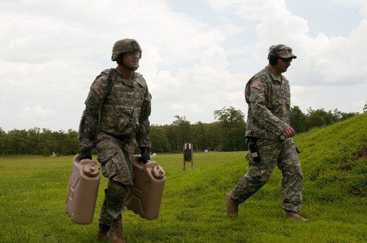 New York Army National Guard Staff Sgt. Jeffrey Dorvee a member of the 1427th Transportation Company carries five-gallon water cans during the 2014 Army National Guard Best Warrior Competition at Camp Joseph T. Robinson Arkansas July 14 2014.
