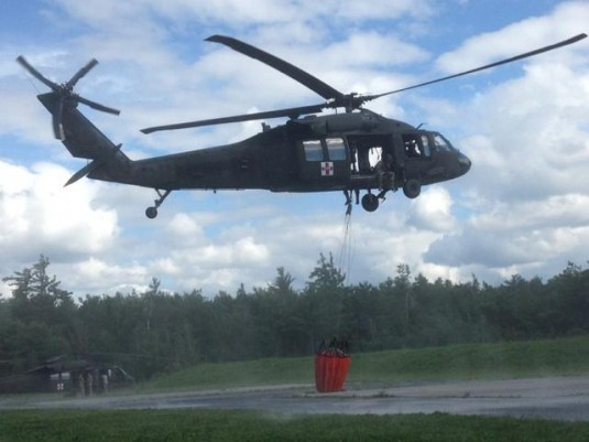 Flight crews from the 1-169th Air Ambulance company conduct Water Bucket training