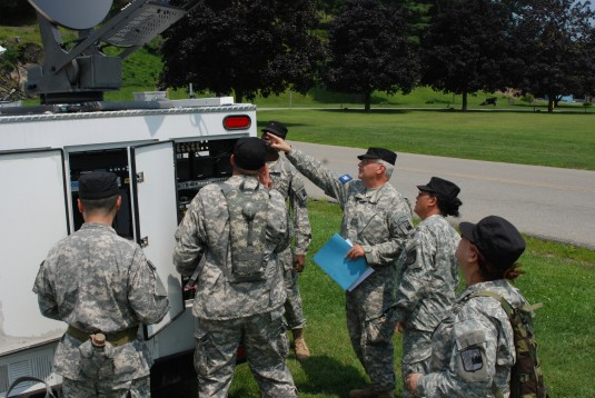 Members of the New York Guard, the state's volunteer and emergency response force, train on a Mobile Emergency Command Center or MERC, during their annual training here on Wednesday, July 23.