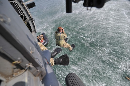 A New York Air National Guard Airman from the 101st Rescue Squadron, an element of the 106th Rescue Wing, jumps from an HH-60 on July 24, 2014 during a joint training exercise with the Rhode Island Army National Guard's Company A 2nd Battalion 19th Sp
