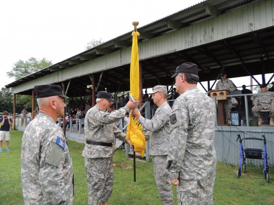 ew York Air National Guard Brig. Gen. Anthony German, the Assistant Adjutant General, transfers the colors of the New York Guard to New York Guard Brig. General Stephen Bucaria during  during Change-of-Command ceremonies here on Saturday, July 26.
