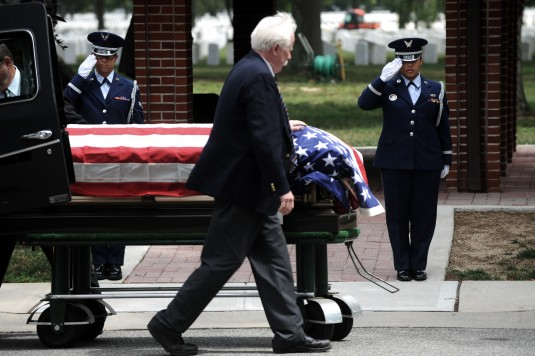 New York Air National Guard Airmen First Class Emilsi Santiago and Larissa Morales both members of the 106th Rescue Wing Honor Guard, render a final salute as the body of Corporal Paul J Ricioppi is laid to rest at Long Island National Cemetery on July 28
