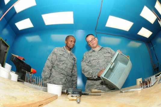New York Air National Guard Senior Tech. Sgt. Dave Cruz a sheet metal mechanic with the 105th Maintenance Group explains the process of repairing C-5M components to General Darren W. McDew Commander Air Mobility Command during a tour of the 105th Airlift