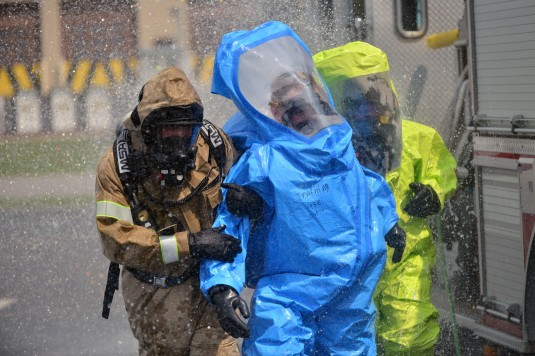 Airmen from the New York Air National Guard conduct a hazardous environment drill during a week-long Emergency Management Course at Niagara Falls Air Reserve Station on August 8, 2014. In this drill one Airman simulated being overcome by the heat of the s