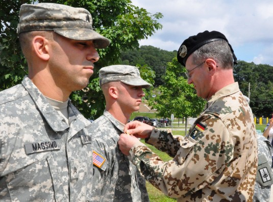 Lt. Col. Rolf Metz German Army Liaison Officer to the United States Military Academy West Point N.Y. presents the German Armed Forces Proficiency Badge to New York Army National Guard Staff Sgt. Jeffrey Dorvee 1427th Transportation Bn Queensbury N.Y durin