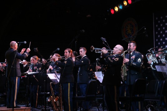 Soldiers of the 42nd Infantry Division Band perform a free concert at Eisenhower Park here on Wednesday, August 13. The Rainbow Division band plays at a series of venues across New York as part of its annual training program. Prior to this appearance the