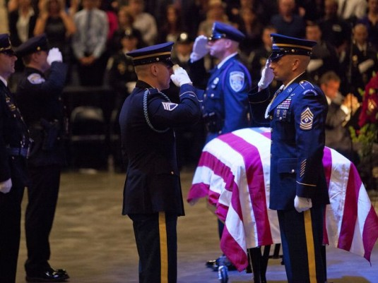 New York Army National Guard 1st Sgt. Daniel Markle,  and Staff Sgt. Kyle King, both from Company A , 2nd Battalion 108th Infantry exchange places while posting a guard of honor on the casket of Rochester Police officer, and former 2nd Battalion 108th Inf