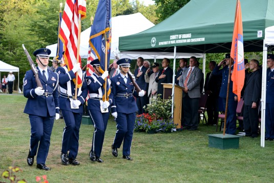 The 105th Airlift Wing Base Honor Guard retires the colors the colors at the close of the Patriot Day September 11th Remembrance ceremony held at the Orange County Arboretum in Thomas Bull Memorial Park Montgomery New York Sept. 11 2014.